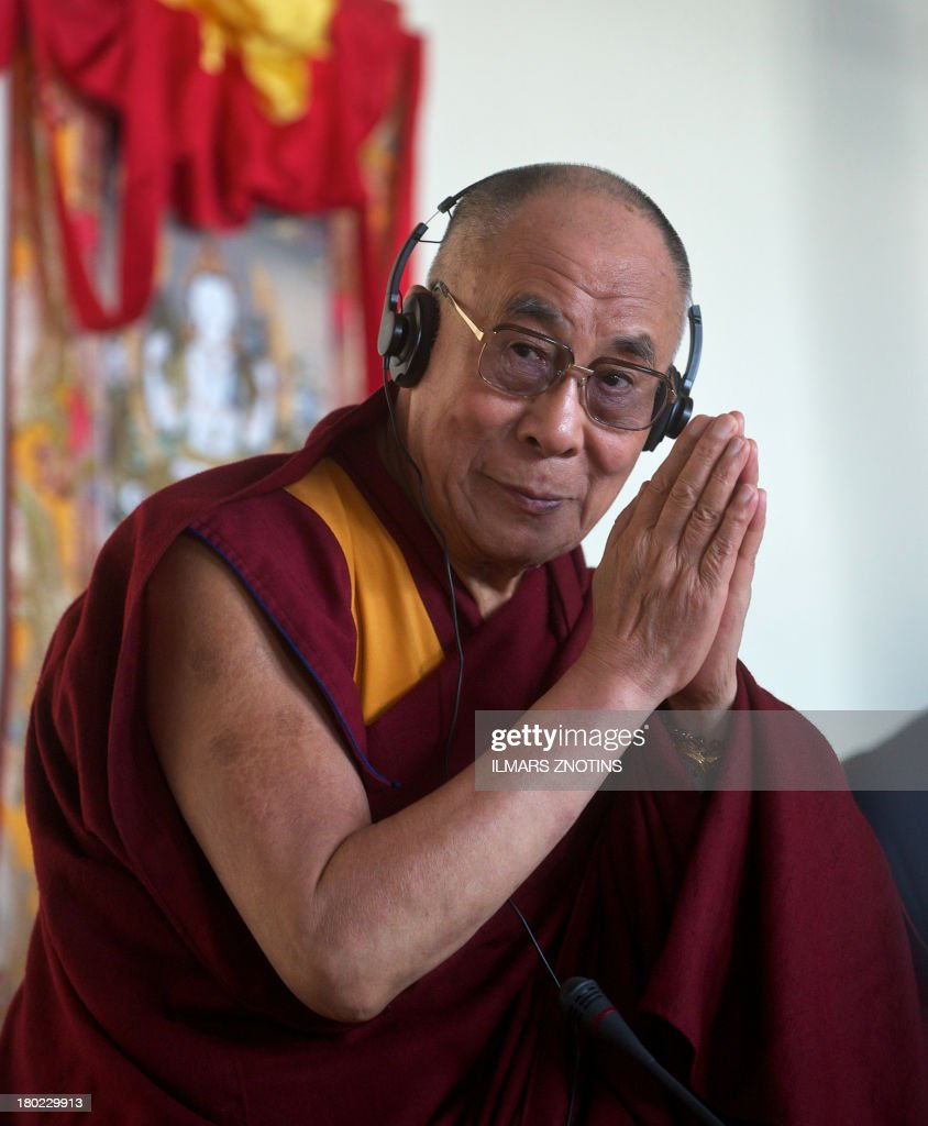 Tibet's exiled spiritual leader, the Dalai Lama, holds a meeting with Latvian Parliament member in Riga, Latvia, on September 10, 2013. AFP PHOTO / ILMARS ZNOTINS