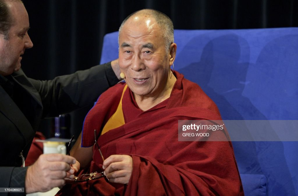 Tibet's exiled spiritual leader the Dalai Lama prepares for a press conference in Sydney on June 13, 2013. The Dalai Lama is on a national tour to Australia for ten days with events throughout the visit carrying the message 'Beyond Religion; Ethics for a Whole World'. AFP PHOTO / Greg WOOD