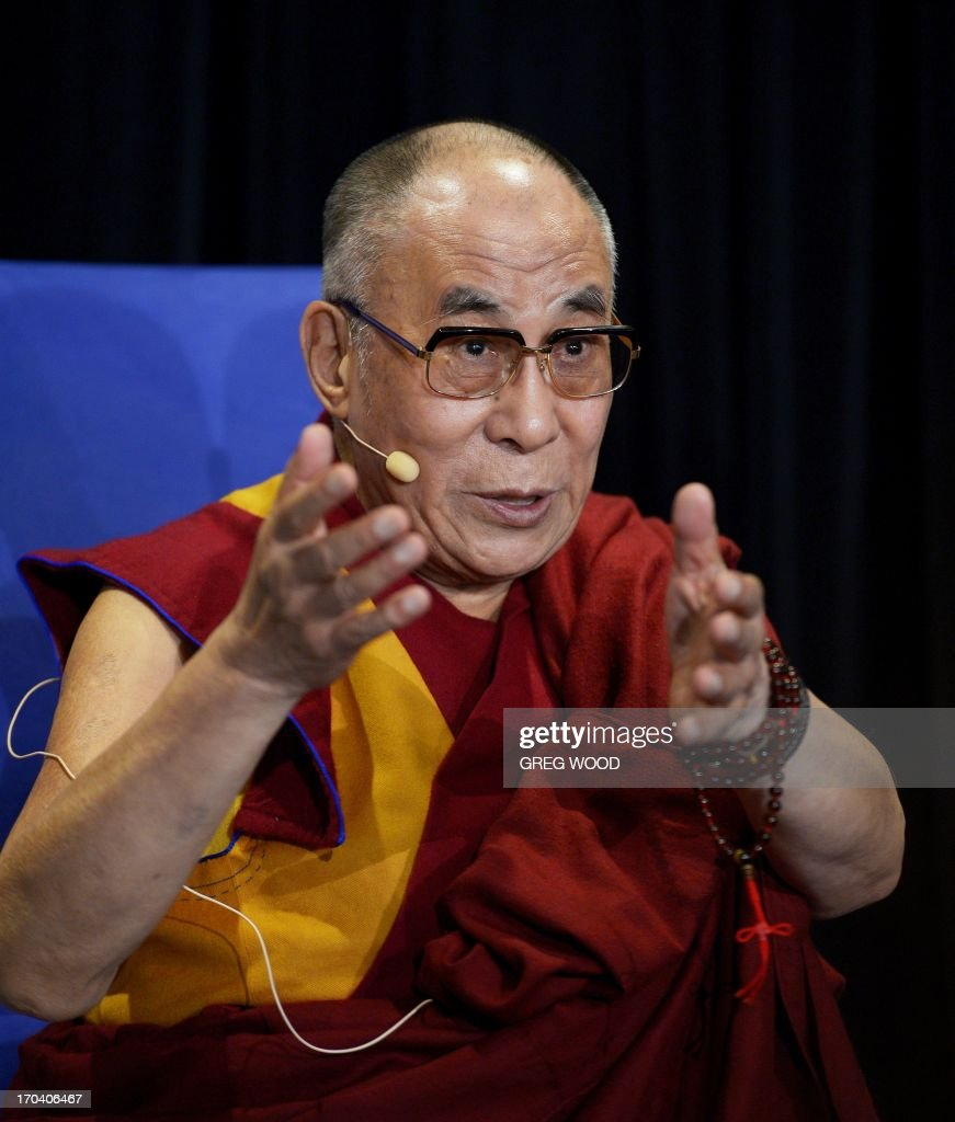 Tibet's exiled spiritual leader the Dalai Lama speaks at a press conference in Sydney on June 13, 2013. The Dalai Lama is on a national tour to Australia for ten days with events throughout the visit carrying the message 'Beyond Religion; Ethics for a Whole World'. AFP PHOTO / Greg WOOD