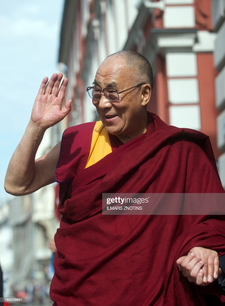 Tibet's exiled spiritual leader, the Dalai Lama, waves as he arrives for a meeting to Latvian Saeima (Parliament) in Riga, Latvia, on September 10, 2013.