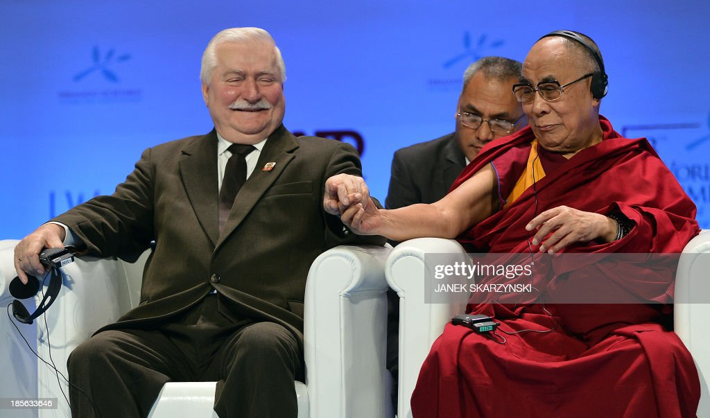 Tibet's spiritual leader the Dalai Lama (R) shakes hands with Former Polish President and 1983 Nobel Peace Laureate Polish Lech Walesa at the end of the World Summit of Nobel Peace Laureates on October 23, 2013 in Warsaw. Warsaw host Nobel Peace Laureates and representatives of organisations interested in peace promotion from all over the world. The summit takes place from October 21-23 under the theme Stand in Solidarity for Peace - Time to Act'.