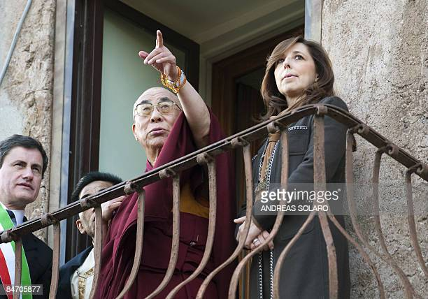 Tibet's spiritual leader the Dalai Lama together with Rome's mayor Gianni Alemanno and his wife Isabella admires the view from a small balcony at the...