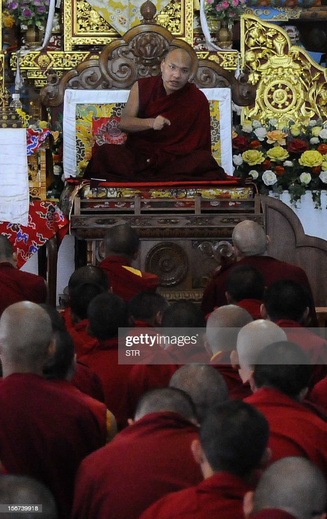 Tibet's third holiest man, the 17th Karmapa Ogyen Trinley Dorjee (C) gives teaching sessions to Buddhist students from various institutions at the Bodhgaya Tergar Monastery in Bodhgaya in the northern Bihar state on November 20, 2012. The Karmapa means 'the one who carries out Buddha activity' and in similiar fashion to the 14th Dalai Lama, the 17th Karmapa also fled his homeland Tibet for various freedoms and now lives in exile in the Indian Himalayan town of Dharamsala also known as the de facto capital of Tibetan exiles. AFP PHOTO