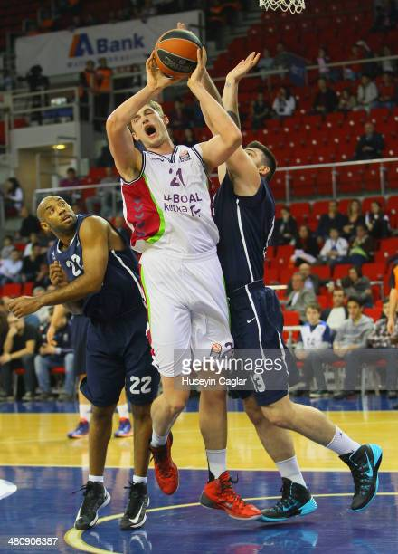 Tibor Pleiss #21 of Laboral Kutxa Vitoria competes with Deniz Kilicli #13 of Anadolu Efes Istanbul in action during the 20132014 Turkish Airlines...
