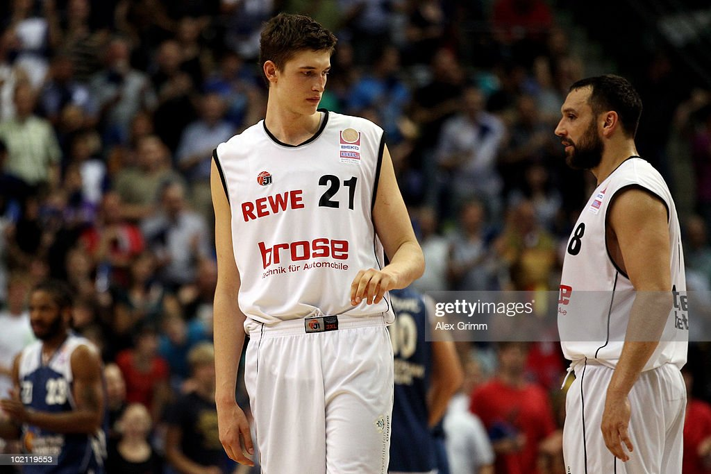 Tibor Pleiss (L) and Predrag Suput of Brose Baskets react during game four of the Beko Basketball Bundesliga play off finals between Deutsche Bank Skyliners and Eisbaeren Bremerhaven at the Ballsporthalle on June 15, 2010 in Frankfurt am Main, Germany.