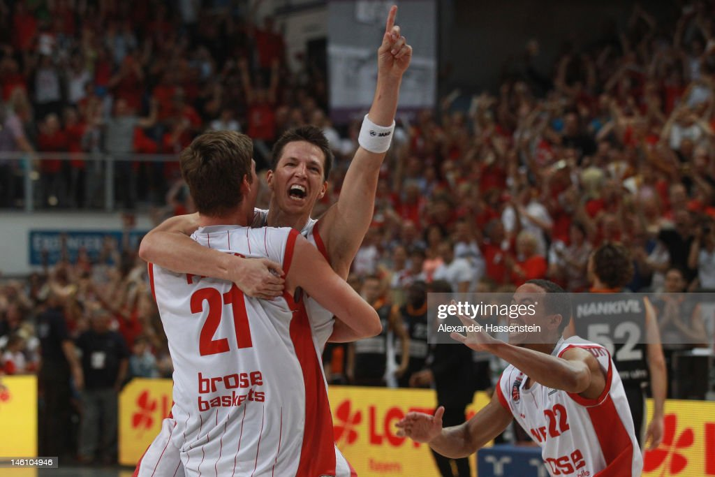 <a gi-track='captionPersonalityLinkClicked' href=/galleries/search?phrase=Tibor+Pleiss&family=editorial&specificpeople=4538830 ng-click='$event.stopPropagation()'>Tibor Pleiss</a> (L) of Bamberg celebrates victory with his team mate <a gi-track='captionPersonalityLinkClicked' href=/galleries/search?phrase=Casey+Jacobsen&family=editorial&specificpeople=201618 ng-click='$event.stopPropagation()'>Casey Jacobsen</a> (C) and Brian Roberts (R) after winning game 3 of the Beko BBL finals between Brose Baskets and ratiopharm Ulm at Stechert Arena on June 10, 2012 in Bamberg, Germany.