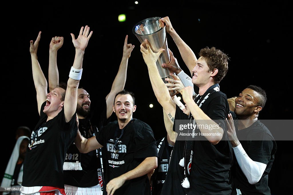 Tibor Pleiss (2nd R) of Bamberg celebrates winning the Germany Championships 2012 with his team mates after winning game 3 of the Beko BBL finals between Brose Baskets and ratiopharm Ulm at Stechert Arena on June 10, 2012 in Bamberg, Germany.