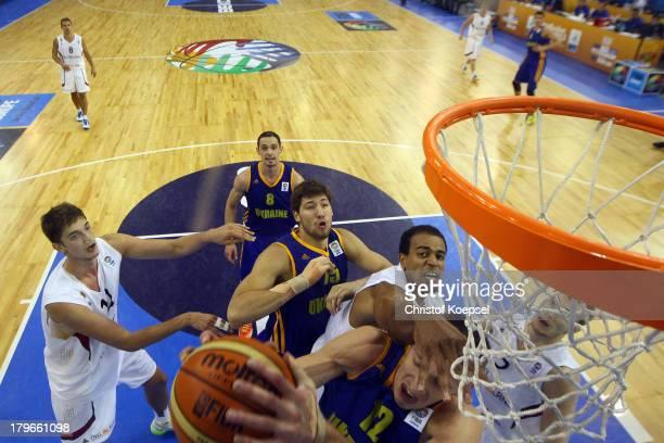 Tibor Pleiss of Gemany Sergii Gladyr Viacheslav Kravtsov and Maxym Korniyenko of Ukriane Alex King and Niels Giffey of Gemany fight for the ball...