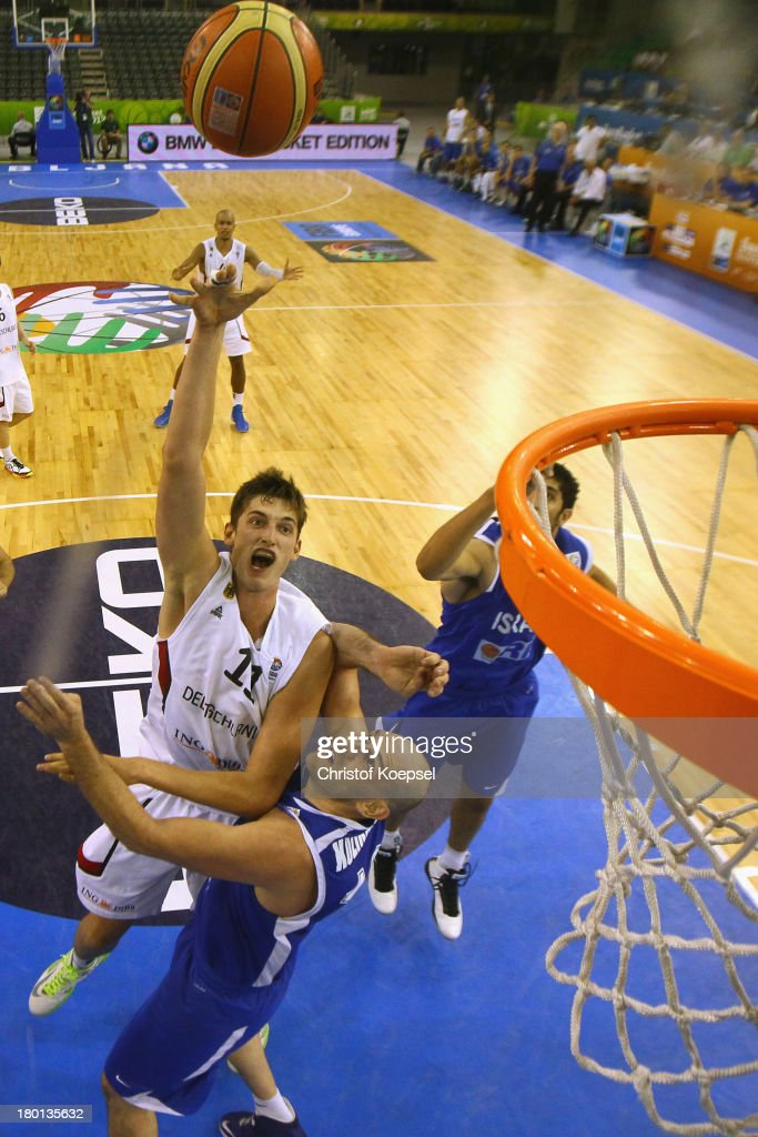 Tibor Pleiss of Gemany (L) shoots over Ido Kozikaro of Israel (R) during the FIBA European Championships 2013 first round group A match between Germany and Israel at Tivoli Arena on September 9, 2013 in Ljubljana, Slovenia. The match between Germany and Israel ended 80-76.