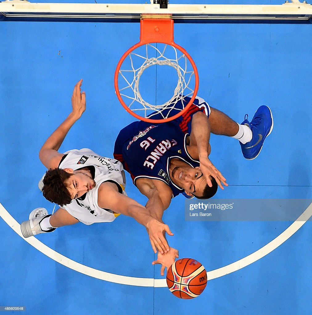 Tibor Pleiss of Germany challenges Rudy Gobert of France during the Men's Basketball friendly match between Germany and France at Lanxess Arena on August 30, 2015 in Cologne, Germany.
