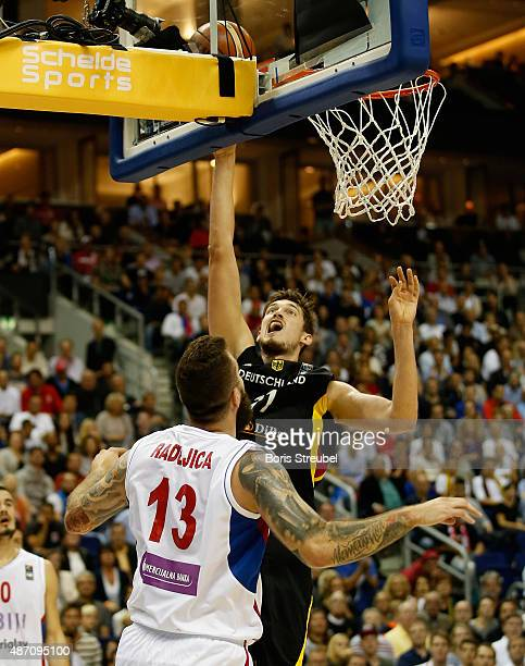 Tibor Pleiss of Germany drives to the basket against Miroslav Raduljica of Serbia during the FIBA EuroBasket 2015 Group B basketball match between...