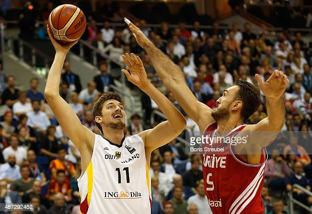 Tibor Pleiss of Germany drives to the basket against Semih Erden of Turkey during the FIBA EuroBasket 2015 Group B basketball match between Germany...