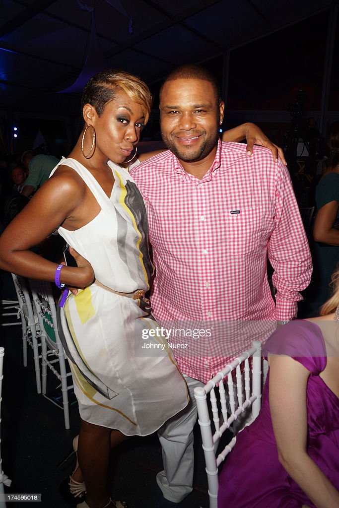 <a gi-track='captionPersonalityLinkClicked' href=/galleries/search?phrase=Tichina+Arnold&family=editorial&specificpeople=593825 ng-click='$event.stopPropagation()'>Tichina Arnold</a> and <a gi-track='captionPersonalityLinkClicked' href=/galleries/search?phrase=Anthony+Anderson&family=editorial&specificpeople=202577 ng-click='$event.stopPropagation()'>Anthony Anderson</a> attend the 14th Annual Art For Life Gala: A Field Of Dreams at Fairview Farms on July 27, 2013 in Bridgehampton, New York.