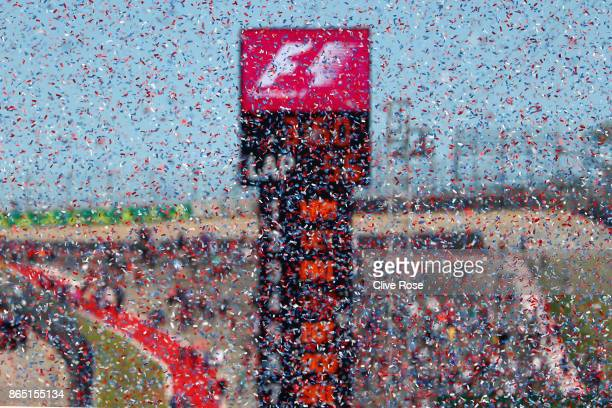 Ticker tape falls during the podium celebrations during the United States Formula One Grand Prix at Circuit of The Americas on October 22 2017 in...