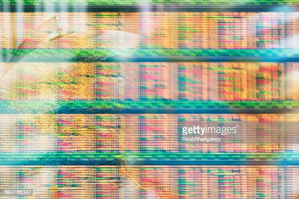 Ticker tape stock market financial data moving quickly on screen