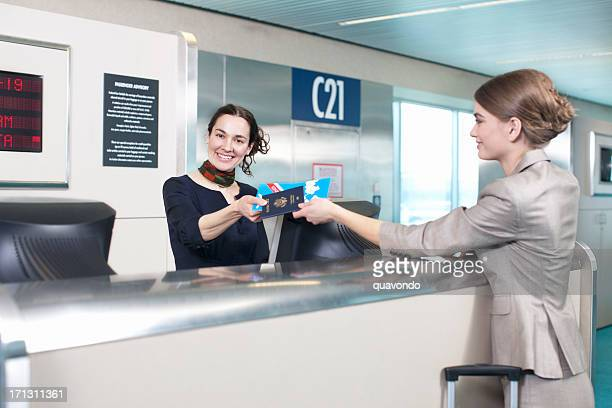 Ticket Agent at Airport Helping Passenger