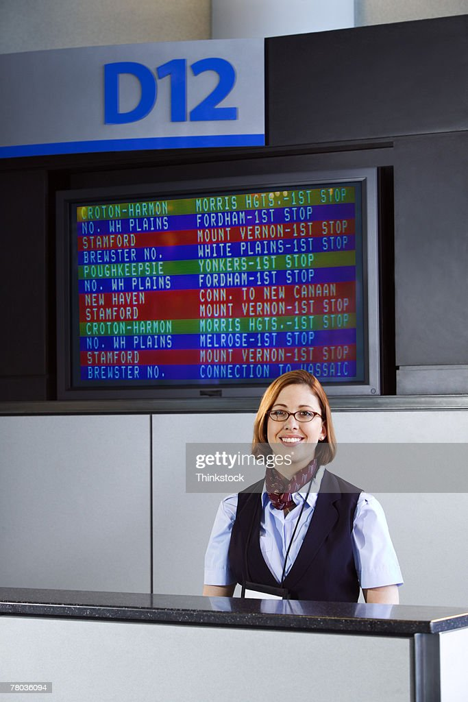Ticket agent at counter in airport