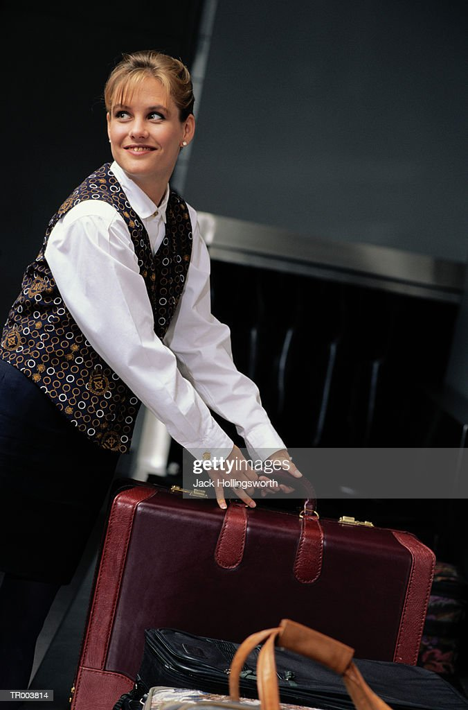 Ticket Agent Getting Luggage