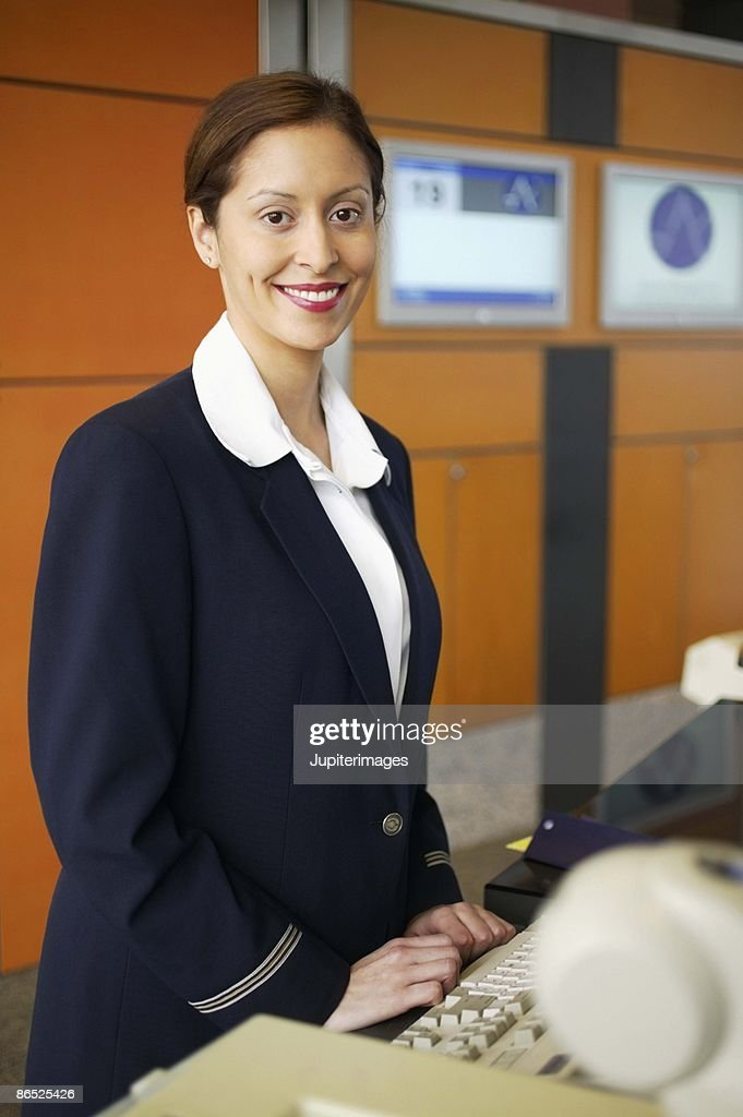 Ticket agent smiling