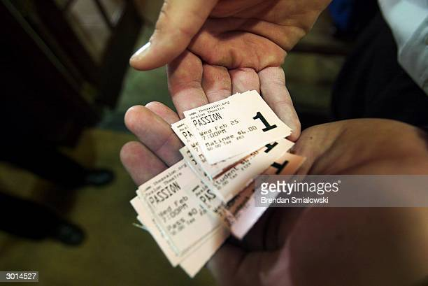 A ticket collector at the Avalon Theater shows a palm full of ticket stubs for the premiere of Mel Gibson's 'The Passion of the Christ' February 25...