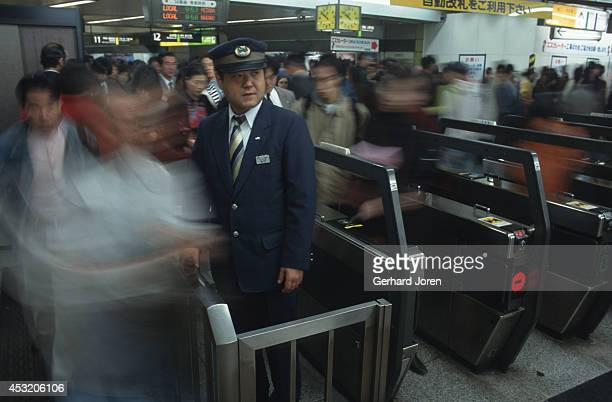 A ticket controller at Shinjuku train station in Tokyo one of the busiest in the world