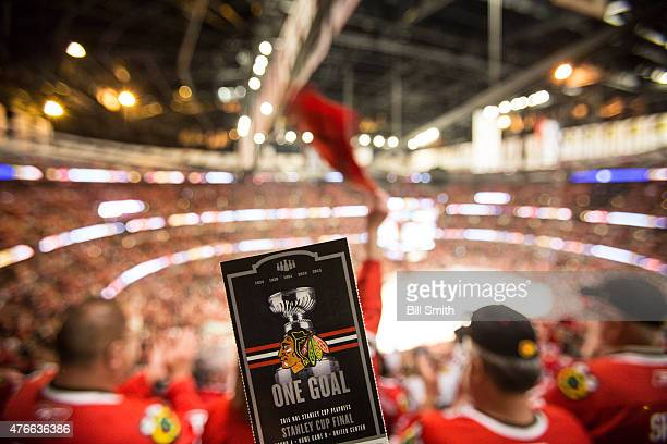 A ticket for Game Four of the 2015 NHL Stanley Cup Final between the Chicago Blackhawks and the Tampa Bay Lightning is held up in the bowl at the...