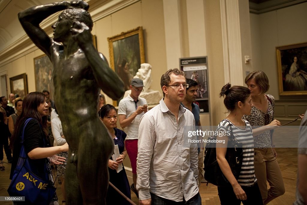 Ticket holders to the 'Alexander McQueen: Savage Beauty' exhibit stand in line at the Metropolitan Museum of Art July 31, 2011 in the Manhattan borough of New York. The exhibit which closes August 7 will be one of the museum's most popular exhibits. McQueen, who committed suicide in 2010, was considered one of the greatest fashion designers of his generation.