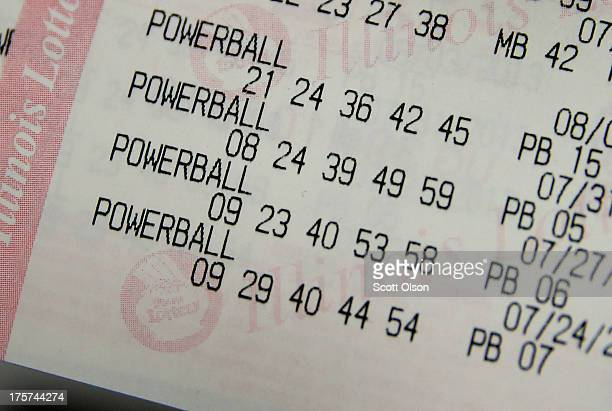 A ticket showing previous Powerball lottery winning numbers sits on the counter at a 7Eleven store on August 7 2013 in Chicago Illinois The Powerball...