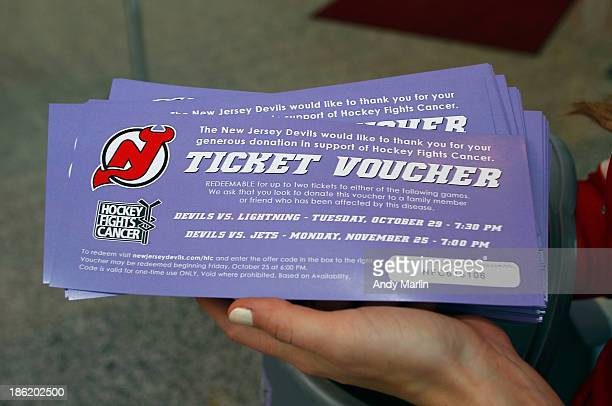 A ticket voucher for upcoming Devils games for a donation to Hockey Fights Cancer Night is displayed prior to the game between the Vancouver Canucks...