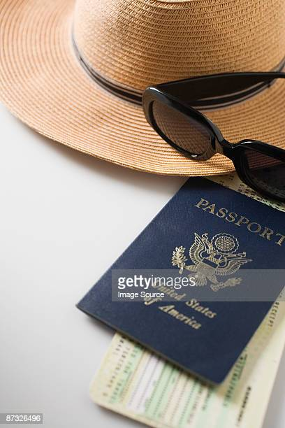 Tickets passport straw hat and sunglasses