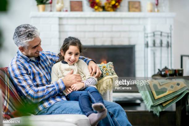 Tickling His Daughter