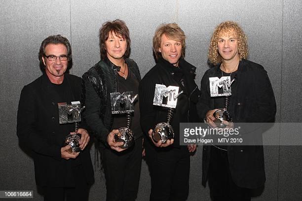 LR Tico torres Richie Sambora Jon Bon Jovi and David Bryan of Bon Jovi pose with their MTV Icon pose in the studio for the MTV Europe Music Awards...