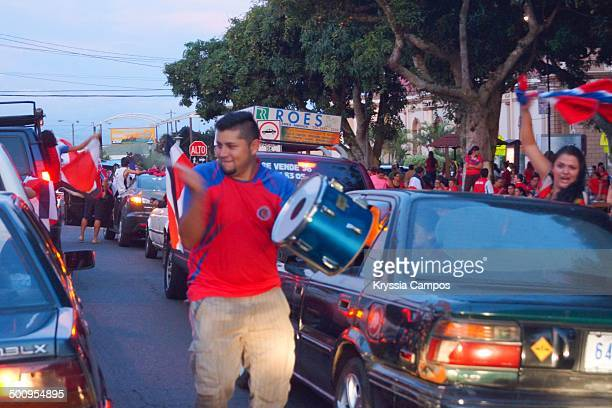 Ticos ticos is what people sings to support Costa Rica at streets man cheers using a drum and his voice in small town in Costa Rica