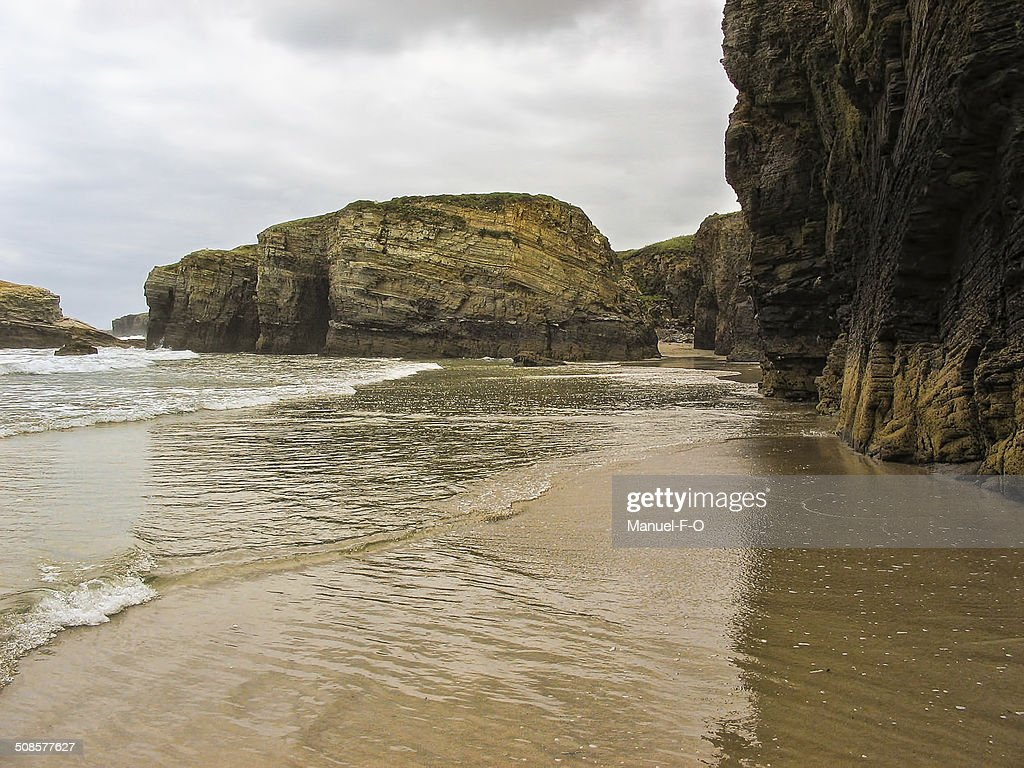 Tide in The Cathedrals beach in Ribadeo Galicia Spain : Stock Photo