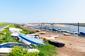 Boats of all sizes are left beached on the sand until the next high tide in Wells-next the-Sea