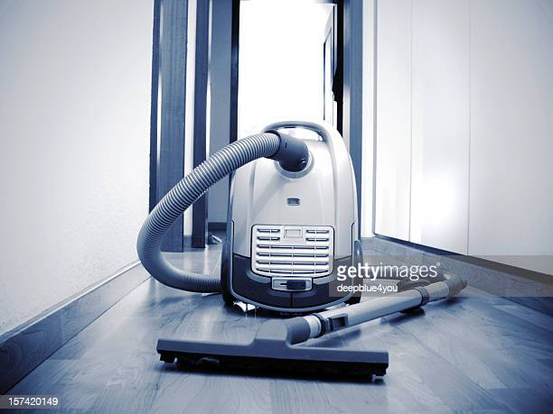 Tidy up the office room - vacuum cleaner