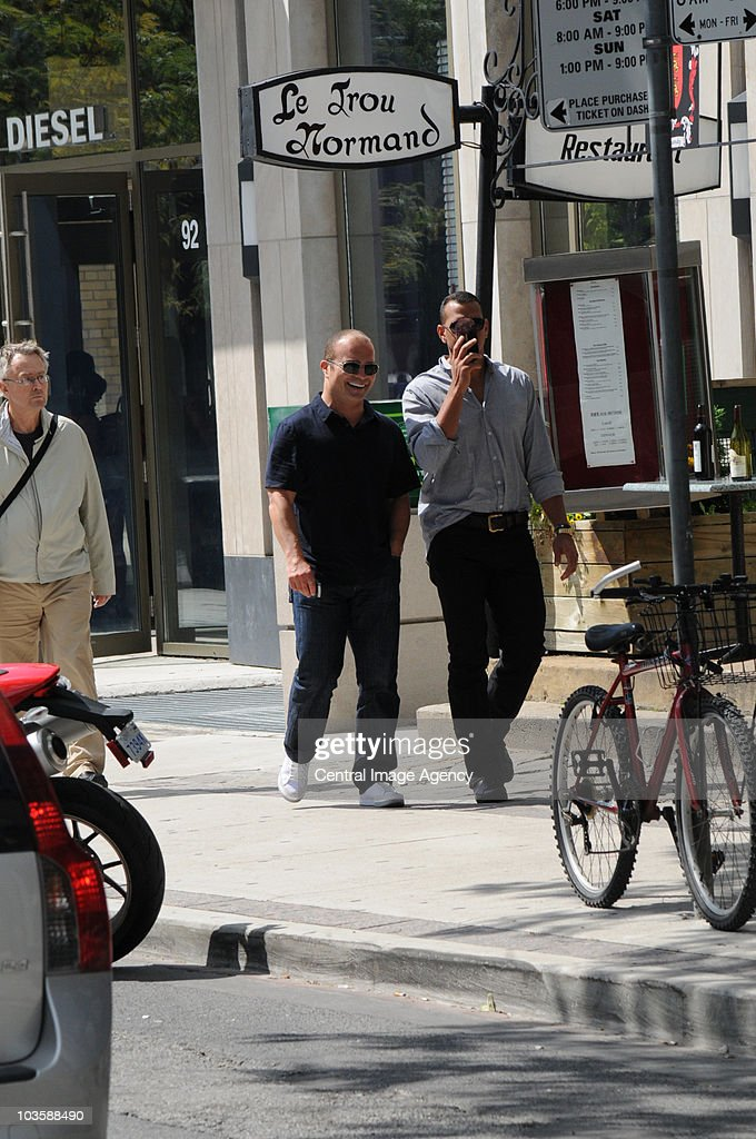 Tie Domi and Alex Rodriguez (R) walk in the city on August 24, 2010 in Toronto, Ontario, Canada.