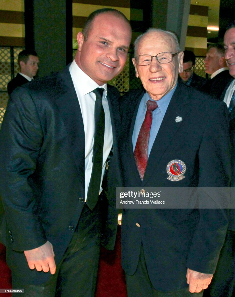 Tie Domi and Johnny Bower arrive at Hockey Hall of Fame induction ceremony.