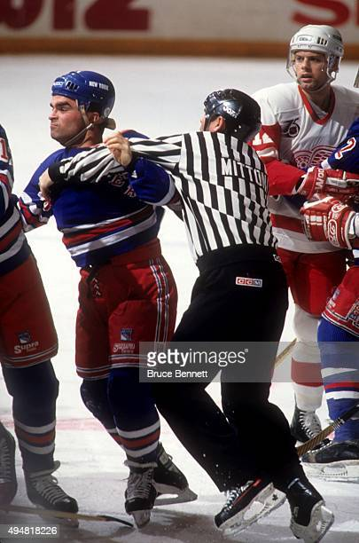 Tie Domi of the New York Rangers tries to get at a Detroit Red Wings players during their game on February 9 1992 at the Madison Square Garden in New...