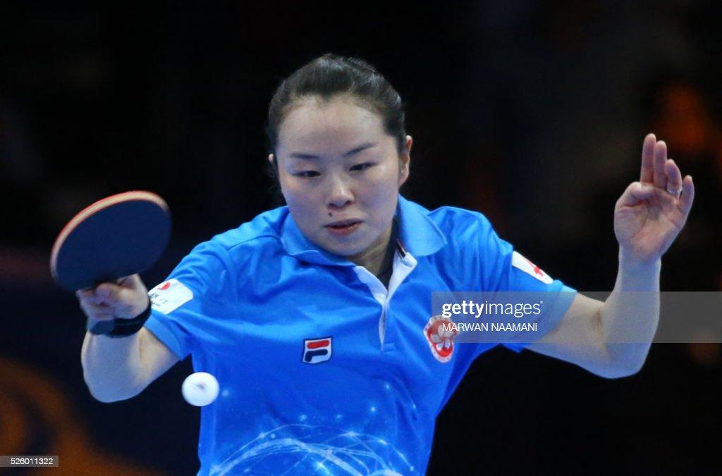 Tie Yana of Hong Kong returns the ball to Liu Shiwen of China during their women's singles semi-final table tennis match in the ITTF Nakheel Table Tennis Asian Cup, on April 29, 2016 in Dubai.. / AFP / MARWAN