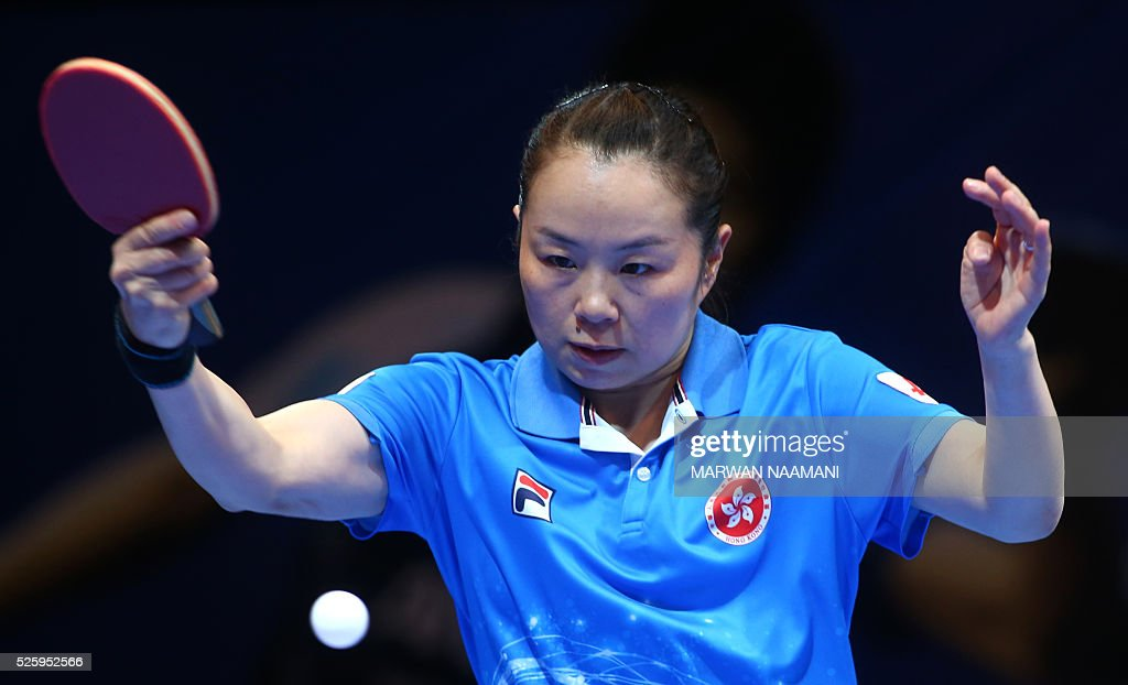 Tie Yana of Hong Kong returns the ball to Yu Mengyu of Singapore during their women's singles quarter final table tennis match in the ITTF Nakheel Table Tennis Asian Cup, in Dubai, on April 29, 2016. / AFP / MARWAN