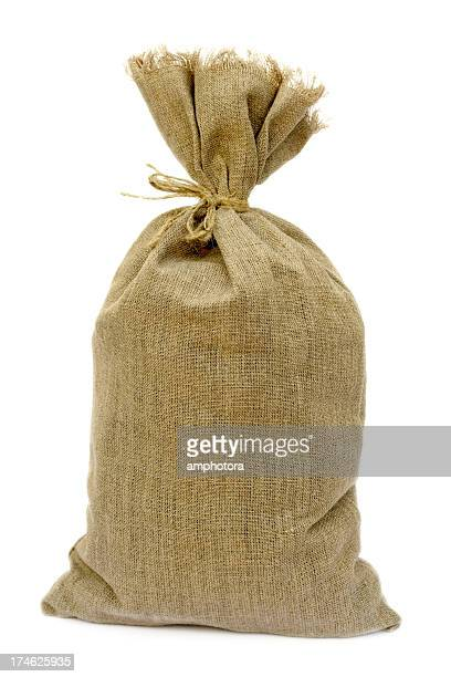Tied brown hemp sack against a white background