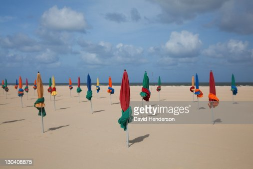 Tied umbrellas on beach