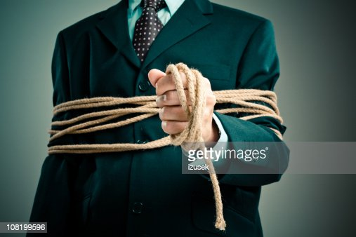 Tied up businessman