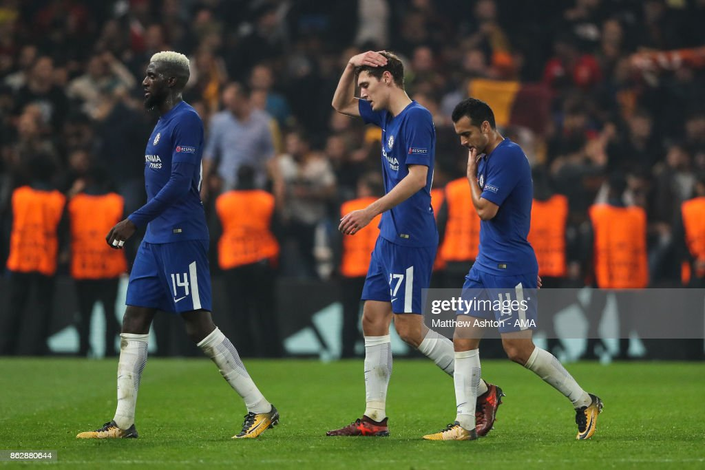 Tiemoué Bakayoko of Chelsea, Andreas Christensen of Chelsea and Pedro of Chelsea walk off the pitch dejected at full time during the UEFA Champions League group C match between Chelsea FC and AS Roma at Stamford Bridge on October 18, 2017 in London, United Kingdom.
