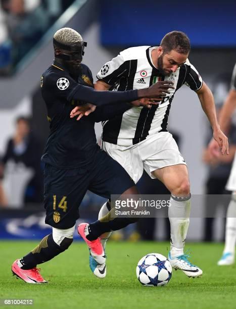 Tiemoue Bakayoko of AS Monaco and Gonzalo Higuain of Juventus clash during the UEFA Champions League Semi Final second leg match between Juventus and...