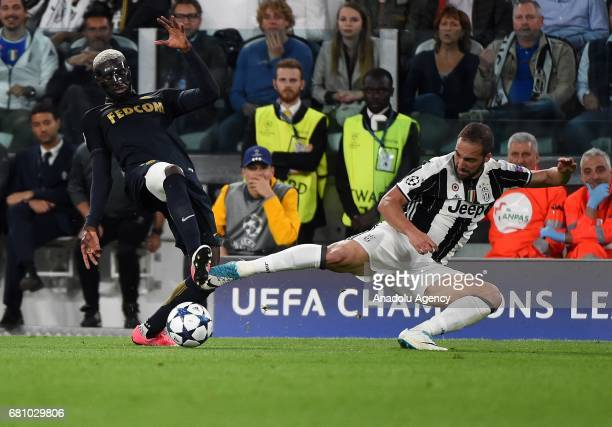 Tiemoue Bakayoko of AS Monaco in action against Gonzalo Higuain of Juventus FC during the UEFA Champions League semi final second leg match between...