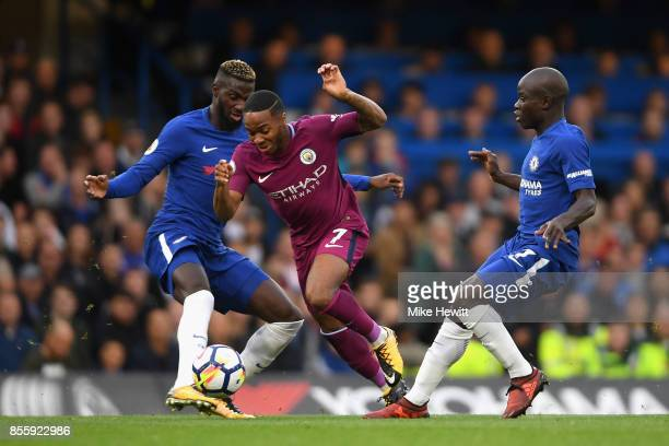 Tiemoue Bakayoko of Chelsea and N'Golo Kante of Chelsea tackle Raheem Sterling of Manchester City during the Premier League match between Chelsea and...