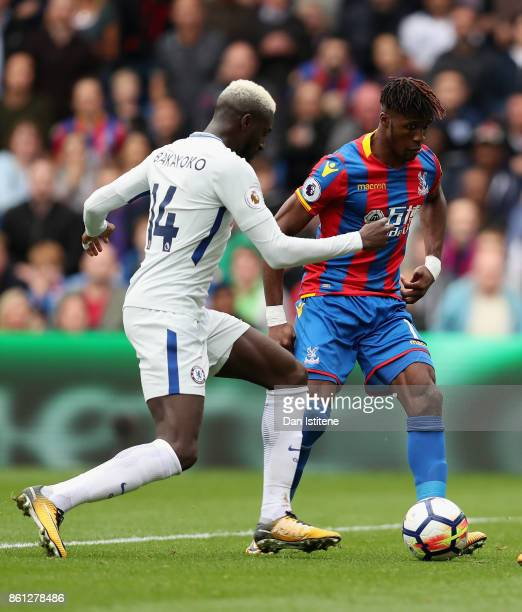 Tiemoue Bakayoko of Chelsea and Wilfried Zaha of Crystal Palace battle for possession during the Premier League match between Crystal Palace and...