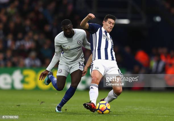 Tiemoue Bakayoko of Chelsea battles with Gareth Barry of West Bromwich Albion during the Premier League match between West Bromwich Albion and...